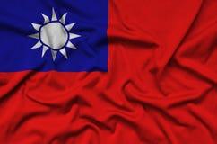 Η σημαία της Ταϊβάν απεικονίζεται σε ένα ύφασμα αθλητικών υφασμάτων με πολλές πτυχές Έμβλημα αθλητικών ομάδων στοκ εικόνες