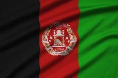 Η σημαία του Αφγανιστάν απεικονίζεται σε ένα ύφασμα αθλητικών υφασμάτων με πολλές πτυχές Έμβλημα αθλητικών ομάδων στοκ φωτογραφία με δικαίωμα ελεύθερης χρήσης