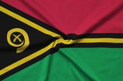Η σημαία του Βανουάτου απεικονίζεται σε ένα ύφασμα αθλητικών υφασμάτων με πολλές πτυχές Έμβλημα αθλητικών ομάδων στοκ φωτογραφίες