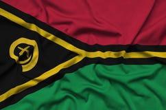 Η σημαία του Βανουάτου απεικονίζεται σε ένα ύφασμα αθλητικών υφασμάτων με πολλές πτυχές Έμβλημα αθλητικών ομάδων στοκ φωτογραφία
