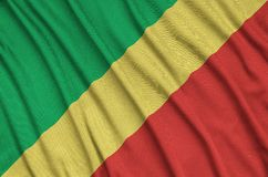Η σημαία του Κονγκό απεικονίζεται σε ένα ύφασμα αθλητικών υφασμάτων με πολλές πτυχές Έμβλημα αθλητικών ομάδων στοκ εικόνες