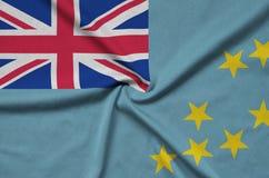 Η σημαία του Τουβαλού απεικονίζεται σε ένα ύφασμα αθλητικών υφασμάτων με πολλές πτυχές Έμβλημα αθλητικών ομάδων στοκ εικόνες