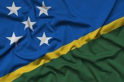 Η σημαία των νήσων του Σολομώντος απεικονίζεται σε ένα ύφασμα αθλητικών υφασμάτων με πολλές πτυχές Έμβλημα αθλητικών ομάδων στοκ εικόνες με δικαίωμα ελεύθερης χρήσης