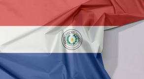 Η σημαία υφάσματος της Παραγουάης crepe και ζαρώνει με το άσπρο διάστημα στοκ εικόνες