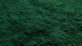 Η σκόνη αλγών Spirulina, κλείνει επάνω Μακροεντολή φιλμ μικρού μήκους