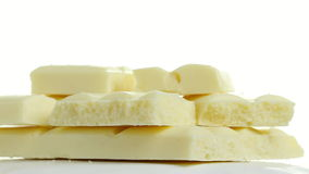 Η σοκολάτα περιστρέφεται ένα λευκό απόθεμα βίντεο
