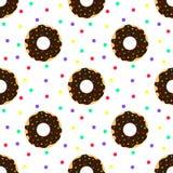 Η σοκολάτα donuts και ζωηρόχρωμος ψεκάζει Στοκ Εικόνες
