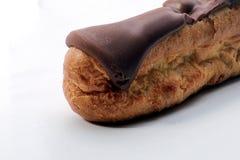 η σοκολάτα ECLAIR ανασκόπησης απομόνωσε το λευκό Στοκ φωτογραφίες με δικαίωμα ελεύθερης χρήσης