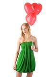 Η στάση γυναικών με τρία τα μπαλόνια Στοκ φωτογραφία με δικαίωμα ελεύθερης χρήσης