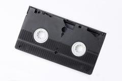 η στενή εικόνα κασετών ανασκόπησης απομόνωσε επάνω το τηλεοπτικό λευκό VHS Στοκ Εικόνα