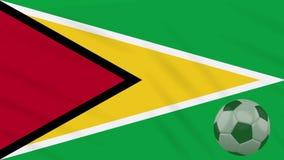 Η σφαίρα κυματισμού και ποδοσφαίρου σημαιών της Γουιάνας περιστρέφεται, βρόχος ελεύθερη απεικόνιση δικαιώματος