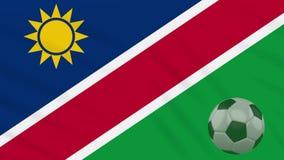 Η σφαίρα κυματισμού και ποδοσφαίρου σημαιών της Ναμίμπια περιστρέφεται, βρόχος ελεύθερη απεικόνιση δικαιώματος