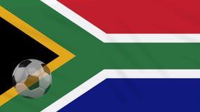 Η σφαίρα κυματισμού και ποδοσφαίρου σημαιών της Νότιας Αφρικής περιστρέφεται, βρόχος ελεύθερη απεικόνιση δικαιώματος