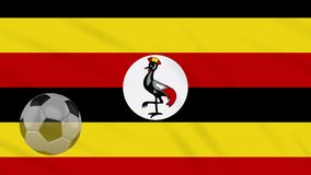 Η σφαίρα κυματισμού και ποδοσφαίρου σημαιών της Ουγκάντας περιστρέφεται, βρόχος ελεύθερη απεικόνιση δικαιώματος