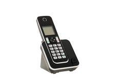 Η σύγχρονη ασύρματη γραμμή εδάφους DECT τηλεφωνά με το σταθμό χρέωσης που απομονώνεται στο λευκό με το ψαλίδισμα της πορείας στοκ εικόνες με δικαίωμα ελεύθερης χρήσης
