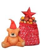 Η σύνθεση Χριστουγέννων με την τσάντα Άγιου Βασίλη και teddy αντέχει το παιχνίδι στοκ εικόνες