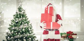 Η σύνθετη εικόνα του santa καλύπτει το πρόσωπό του με παρουσιάζει Στοκ Φωτογραφία