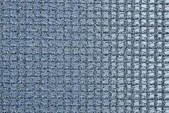 Η σύσταση του υποβάθρου ενός συνθετικού κλωστοϋφαντουργικού προϊόντος υπό μορφή τετραγωνικού δικτυωτού πλέγματος στοκ εικόνες