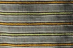 Η σύσταση του χειροποίητου τάπητα έκανε στον χέρι-αργαλειό, σχέδιο των κίτρινων, πορτοκαλιών και μαύρων κάθετων γραμμών που διαιρ Στοκ Εικόνα