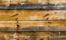 Η σύσταση υποβάθρου ξεπέρασε τον ξύλινο τοίχο με τα απανθρακωμένα σημεία Στοκ Εικόνες