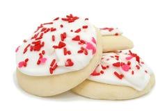 η τήξη καρδιών μπισκότων ψεκάζει το λευκό Στοκ Φωτογραφία