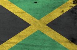 Η τζαμαϊκανή σύσταση σημαιών Grunge, χρυσός διαγώνιος σταυρός Α διαιρεί τον τομέα σε τέσσερα τρίγωνα πράσινος και μαύρος διανυσματική απεικόνιση