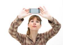 η τηλεφωνική εικόνα παίρνει τη γυναίκα Στοκ Φωτογραφία