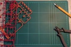 Η τοπ άποψη του εργαλείου και ο εξοπλισμός για το πλαστικό πρότυπο χτίζουν Στοκ Εικόνες