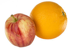 Η φρέσκια τριζάτη Apple με το Juicy πορτοκάλι Στοκ Φωτογραφίες