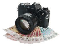 Η φωτογραφική μηχανή στα χρήματα (η φωτογραφία - ως αποδοχές) Στοκ Φωτογραφία