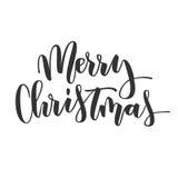 Η Χαρούμενα Χριστούγεννα δίνει τη γραπτή επιγραφή Στοκ εικόνα με δικαίωμα ελεύθερης χρήσης