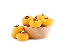 Η χρυσή Apple, decandra Lour Diospyros Ταϊλανδικά φρούτα και ταϊλανδικό herbon Στοκ Φωτογραφίες