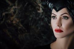 Η όμορφη γυναίκα έντυσε όπως επιβλαβής Στοκ εικόνα με δικαίωμα ελεύθερης χρήσης