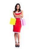 Η όμορφη γυναίκα με αγορές τοποθετεί σε σάκκο. Στοκ εικόνες με δικαίωμα ελεύθερης χρήσης