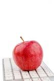 Η Apple βρίσκεται σε ένα πληκτρολόγιο Στοκ Εικόνες