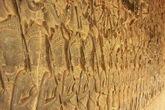 Η bas-ανακούφιση τοίχων, ναός Angkor Wat, Siem συγκεντρώνει Στοκ Φωτογραφία