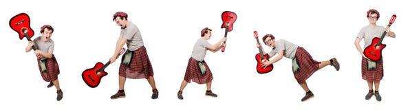 Η scotsman κιθάρα παιχνιδιού που απομονώνεται στο λευκό Στοκ Φωτογραφίες