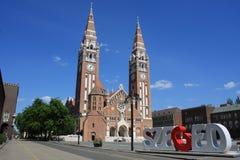 Η Votive εκκλησία και ο καθεδρικός ναός της κυρίας Ουγγαρίας μας είναι α δίδυμος-Ρωμαίος - καθολικός καθεδρικός ναός σε Szeged, Ο Στοκ Φωτογραφίες
