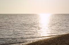 Θάλασσα ηλιοβασιλέματος βράδυ Στοκ Εικόνα