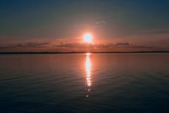 Θάλασσα νερού ηλιοβασιλέματος Στοκ Εικόνες