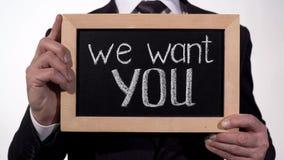 Θέλουμε εσείς διατυπώνουμε στον πίνακα στα χέρια επιχειρηματιών, ελπιδοφόρος την προσφορά εργασίας στοκ εικόνα