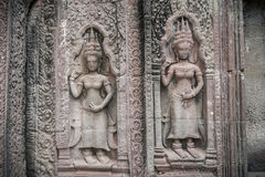 Θέση γλυπτικών Apsara στον τοίχο του ναού Angkor, κόσμος herit Στοκ Εικόνες