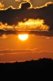 θέτοντας ήλιος σκιαγραφιών Στοκ Εικόνες
