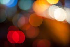 Θαμπάδα και ζωηρόχρωμος κύκλος bokeh στο σκοτεινό υπόβαθρο Στοκ Εικόνες