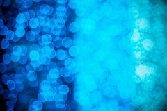 Θαμπάδα του μπλε και του φωτός aqua bokeh τη νύχτα Στοκ Εικόνες