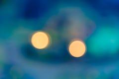 Θαμπάδα bokeh του φωτός δύο με το πράσινο υπόβαθρο aqua Στοκ Εικόνες