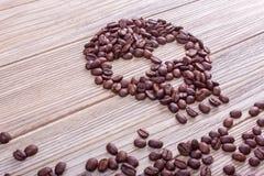 Θανατώσεις, κρανίο και crossbones σύμβολο καφέ Στοκ φωτογραφίες με δικαίωμα ελεύθερης χρήσης
