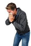 Θερμά ντυμένο άτομο που φυσά τη μύτη του Στοκ Εικόνες
