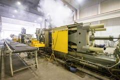 Θερμαντικά σώματα τήξης και θέρμανσης ζωγραφικής στην κατασκευή Στοκ Εικόνες