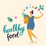 Θετικό κορίτσι σώματος με τις υγιείς αγορές τρόπου ζωής ελεύθερη απεικόνιση δικαιώματος